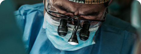 Surgeon with surgical loupe and headlight in the operating room